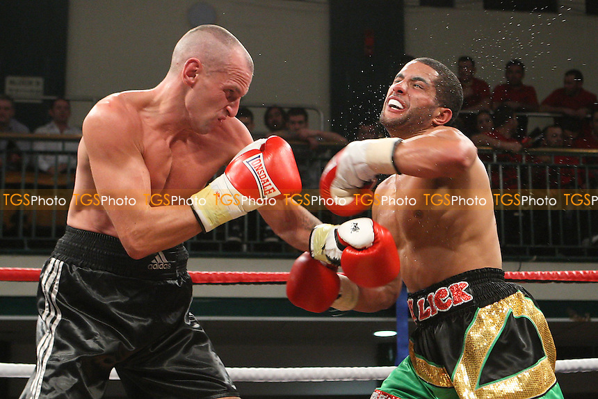 Nathan Graham (gold/green/black shorts) defeats Aletsander Rayojuks in a Welterweight boxing contest at York Hall, Bethnal Green, promoted by Spencer Fearon / Hard Knocks Promotions - 07/10/11 - MANDATORY CREDIT: Gavin Ellis/TGSPHOTO - Self billing applies where appropriate - 0845 094 6026 - contact@tgsphoto.co.uk - NO UNPAID USE.