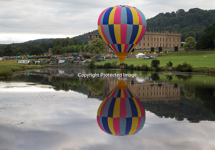 "04/09/15<br /> <br /> ***WITH VIDEO***<br /> <br /> Hot air balloon pilots attempt to dip their baskets into the river Derwent before taking off again above Chatsworth House.  A mass launch at dawn this morning marked the start of the three-day Chatsworth Country Fair in the Derbyshire Peak District.<br /> <br /> A Chatsworth park ranger said: ""They try to do it every year, but I've only ever seen one manage it before - they need conditions to be perfect - I think it's like the holy grail for the pilots""<br /> <br /> Another crew member shouted down from his basket that his pilot didn't want to get his new shoes wet after failing to get low enough for a splash-down.<br /> <br /> <br /> All Rights Reserved: F Stop Press Ltd. +44(0)1335 418629   www.fstoppress.com."