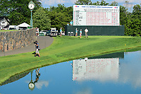 A lone photographer reflects off the lake as he shoots tee shots on 16 during Sunday's final round of the 72nd U.S. Women's Open Championship, at Trump National Golf Club, Bedminster, New Jersey. 7/16/2017.<br /> Picture: Golffile | Ken Murray<br /> <br /> <br /> All photo usage must carry mandatory copyright credit (&copy; Golffile | Ken Murray)