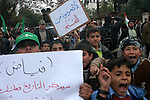 """Palestinian students hold a Placards read in arabic """"don't deprive us from our rights of learning"""" as they attend a rally to protest against the prohibition of the introduction of textbooks and stationery to Gaza Strip's schools, in front of the headquarters of UN in Gaza City."""