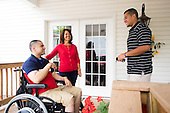 Afganistan war vet Josh Himan chats with his mother and brother at their home in Woodbridge, VA.
