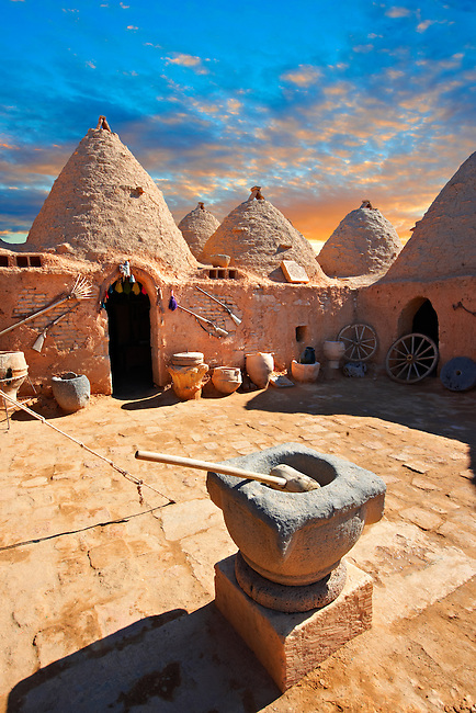 """Pictures of the beehive adobe buildings of Harran, south west Anatolia, Turkey.  Harran was a major ancient city in Upper Mesopotamia whose site is near the modern village of Altınbaşak, Turkey, 24 miles (44 kilometers) southeast of Şanlıurfa. The location is in a district of Şanlıurfa Province that is also named """"Harran"""". Harran is famous for its traditional 'beehive' adobe houses, constructed entirely without wood. The design of these makes them cool inside. 25"""