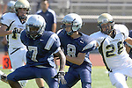 Torrance, CA 09/08/11 - unidentified North player and Issac Kuo (Peninsula #28) in action during the North-Peninsula Junior Varsity Football game at North High School in Torrance.