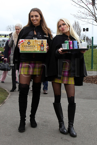 08.04.2016. Aintree, Liverpool, England. Crabbies Grand National Festival Day 2. Crabbie's girls handing out refreshments.