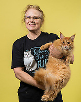 Lynzcey Rkein of Oakland, Calif. holds her Maine Coone named Ragnar at the 44th East of Eden Cat Fancier's in Monterey, Calif. on Feb. 22, 2020.