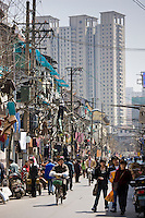 Busy street scene in Zi Zhong Road, old French Quarter in Shanghai, China