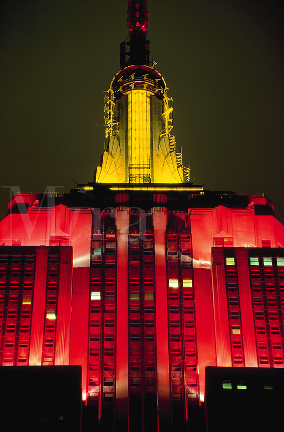Detail of colored lights on Empire State Building at night, New York City
