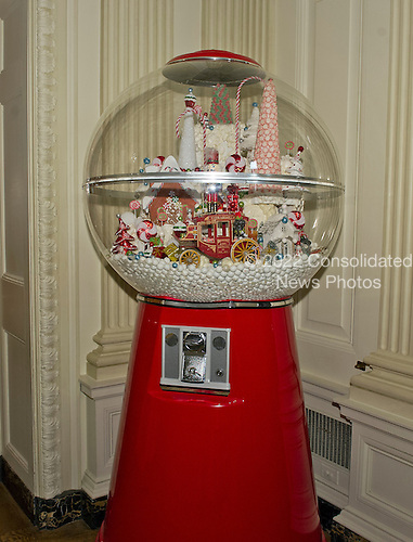 A gum ball machine with 4,000 gum balls in the State Dining Room as part of the 2015 White House Christmas theme &quot;A Timeless Tradition&quot; at the White House in Washington, DC on Wednesday, December 2, 2015.  The decorations include a six foot teddy bear and hundreds of vintage nutcrackers.<br /> Credit: Ron Sachs / CNP