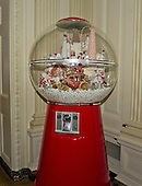 """A gum ball machine with 4,000 gum balls in the State Dining Room as part of the 2015 White House Christmas theme """"A Timeless Tradition"""" at the White House in Washington, DC on Wednesday, December 2, 2015.  The decorations include a six foot teddy bear and hundreds of vintage nutcrackers.<br /> Credit: Ron Sachs / CNP"""
