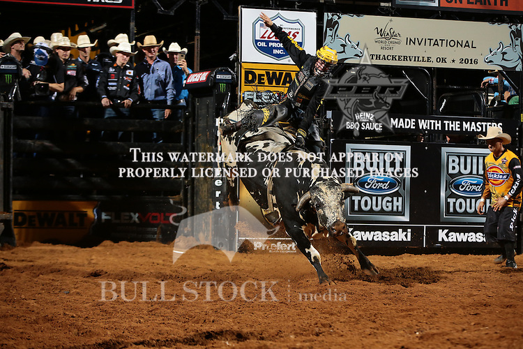 Jess Lockwood rides Viducic/B-B Bucking Bulls's Shake It Up for 86.5 during the first round of the Thackerville Built Ford Tough series PBR.  Photo Copyrighted. Photo credit must be given on all uses. Photo by Andy Watson / Bull Stock Media
