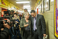 NYC Dept. of Education Chancellor Carmen Fariña, left, speaks with Principal Dr. Ramon Gonzalez during her visit to MS 223, The Laboratory School of Finance and Technology, in the Bronx borough of New York on Thursday, January 2, 2014, her first day of work.New York Mayor Bill De Blasio appointed career educator Fariña as the head of the New York City public school system.  (© Richard B. Levine)