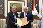 Palestinian President Mahmoud Abbas receives the annual report of Palestinian Pension Authority, at his headquarter in the West Bank city of Ramallah, May 14, 2019. Photo by Thaer Ganaim