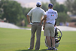 Padaig Harrington and caddy Ronan Flood contemplate his 2nd shot on the 2nd hole during  Day 2 at the Dubai World Championship Golf in Jumeirah, Earth Course, Golf Estates, Dubai  UAE, 20th November 2009 (Photo by Eoin Clarke/GOLFFILE)