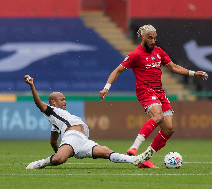 Bristol City's Ashley Williams (right) is tackled by Swansea City's Andre Ayen (left) <br /> <br /> Photographer David Horton/CameraSport<br /> <br /> The EFL Sky Bet Championship - Swansea City v Bristol City- Saturday 18th July 2020 - Liberty Stadium - Swansea<br /> <br /> World Copyright © 2019 CameraSport. All rights reserved. 43 Linden Ave. Countesthorpe. Leicester. England. LE8 5PG - Tel: +44 (0) 116 277 4147 - admin@camerasport.com - www.camerasport.com