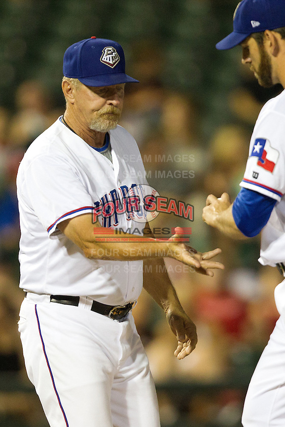 Round Rock Express manager Bobby Jones #31 visits the mound to remove starting pitcher Zach Jackson #47 during the Pacific Coast League baseball game against the Fresno Grizzlies on May 18, 2012 at The Dell Diamond in Round Rock, Texas. The Grizzlies defeated the Express 5-2. (Andrew Woolley/Four Seam Images)