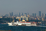 A ferry boat on the Golden Horn passes Istanbul's changing skyline, Turkey