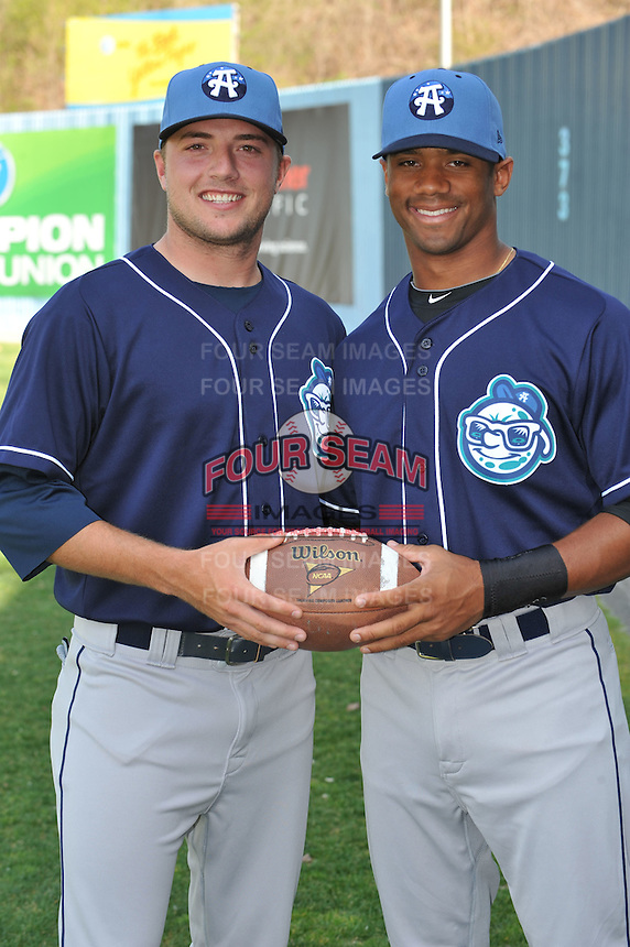 Kyle Parker #8 and Russell Wilson #3 former College Quaterbacks now of the Asheville Tourists pose during media day at McCormick Field on April 4, 2011 in Asheville, North Carolina.  Photo by Tony Farlow / Four Seam Images..