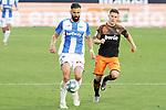 CD Leganes' Dimitrios Siovas (l) and Valencia CF's Kevin Gameiro during La Liga match. July 12,2020. (ALTERPHOTOS/Acero)