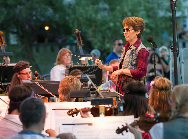 "Conductor Maestro Laura Jackson during the Pops on the River ""A night at Woodstock"" concert at Wingfield Park in downtown Reno on Saturday, July 13, 2019. during the Pops on the River ""A night at Woodstock"" concert at Wingfield Park in downtown Reno on Saturday, July 13, 2019."