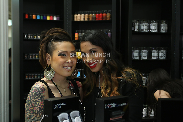 MAC Cosmetics staff pose during  the Makeup Show NYC, in the Metropolitan Pavilion, May 15 2011.