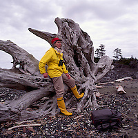 Hiker hiking on West Coast of Vancouver Island, BC, British Columbia, Canada (Model Released)