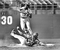 Oakland A's Rodney Scott completed double play.Cleveland Pruitt sliding.<br />