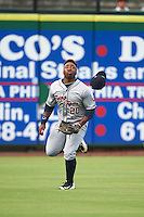 Lakeland Flying Tigers left fielder Christin Stewart (20) loses his hat while chasing down a fly ball during a game against the Clearwater Threshers on August 5, 2016 at Bright House Field in Clearwater, Florida.  Clearwater defeated Lakeland 3-2.  (Mike Janes/Four Seam Images)