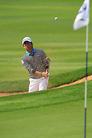 Kim Seung-hyuk (KOR) chips from a bunker at the 9th green during Sunday's Final Round of the 2014 BMW Masters held at Lake Malaren, Shanghai, China. 2nd November 2014.<br /> Picture: Eoin Clarke www.golffile.ie