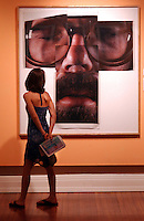 A Visitor looks at the 1979 Chuck Close self portrait a polaroid 20x24 Polacolor photographs internal dye diffusion transfer at the Pensacola Museum of Art.