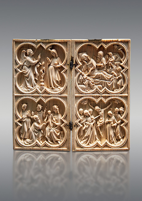 Medieval Gothic ivory diptych depicting the Annunciation, Nativity, the adoration of the Magi and the crucifixion  made in Paris in second quarter of the 14th century.  inv 103, The Louvre Museum, Paris.