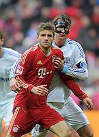 FUSSBALL   1. BUNDESLIGA  SAISON 2011/2012   23. Spieltag  26.02.2012 FC Bayern Muenchen - FC Schalke 04        Thomas Mueller (vorn, C Bayern Muenchen) gegen Benedikt Hoewedes (FC Schalke 04)