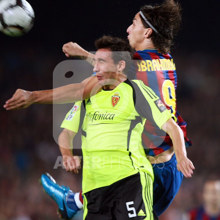 Football Season 2009-2010. Barcelona's player Zlatan Ibrahimovic (R) is challanged against Zaragoza's  Pablo Amo (L) during their Spanish first division soccer match at Camp Nou stadium in Barcelona October 25, 2009