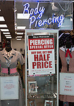 Body piercing offer at Blue Banana inside shopping mall, Brunel Centre, Swindon, Wiltshire, England, UK