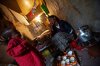 Tlbech, 27 years old, and her son Zarhiun, 4, both HIV positive prepare traditional coffee in their small house in one of the poorest neighborhoods in Addis Ababa, ethiopia on Thursday July 27 2006..Talbech and Zarihun live on a 180 birr ( 20 USD ) per month sponsorship from the HfC NGO. they spend 100 Birr for rent leaving less than 10 USD for food and other necessities. Nevertheless they are a privileged family in the country..Tlbech besides fighting againt the virus and taking care of her child provides home base care assistance in Addis to other HIV patients in need..Ethiopia is one of the countries most affected by HIV/AIDS. Of its population of 77 million, three million are HIV-positive, according to government statistics. Every day sees 1,000 new infections. A million children under 14 have lost one or both parents to AIDS, and 200,000 children are living with AIDS. That makes Ethiopia the country with the most HIV-positive children.