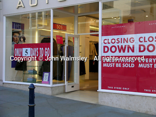"""Closing Down Sale sign in shop window, """"Everything must be sold""""."""