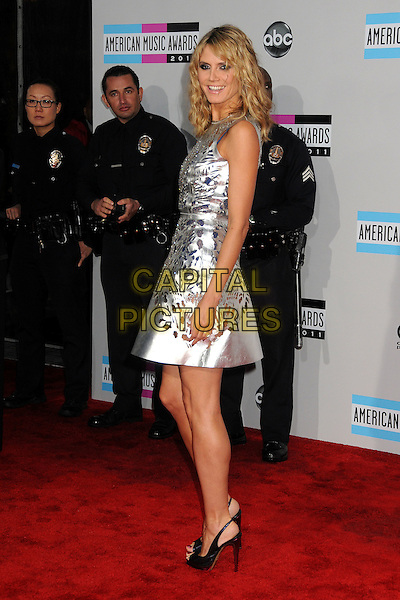 Heidi Klum.2011 American Music Awards - Arrivals held at Nokia Theatre LA Live, Los Angeles, California, USA..November 20th, 2011.ama amas ama's full length silver sleeveless silk satin perforated dress cut out away pattern open toe shoes black side policemen police officers .CAP/ADM/BP.©Byron Purvis/AdMedia/Capital Pictures.