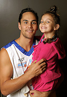 Troy McLean with his daughter. Wellington Saints headshots at Te Rauparaha Arena, Porirua, Wellington, New Zealand on Tuesday, 12 April 2011. Photo: Dave Lintott / lintottphoto.co.nz