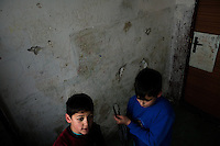 Boys pass through an apartment block asking for Easter eggs in the Gipsy ghetto of Chanov, Most, Czech Republic, 26 March 2008.