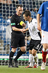 Ref Stevie O'Reilly shakes the hand of Derek Young after booking the player for a challenge on Ian Black