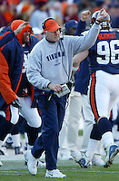 Virginia head coach Al Groh celebrates a 3rd quarter touchdown from the sidelines during the 35-21 Virginia win over the Hokies in Charlottesville, Va.