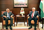 (FILES) This file photo taken April 13, 2013 shows Palestinian President Mahmoud Abbas (Abu Mazen) accepts resignation Palestinian prime minister Salam Fayyad in the West Bank city of Ramallah. According to media, a sudden meeting was held between Palestinian President Mahmoud Abbas and former Palestinian Prime Minister Salam Fayyad, before days ago, in the West Bank city of Ramallah. Photo by Thaer Ganaim