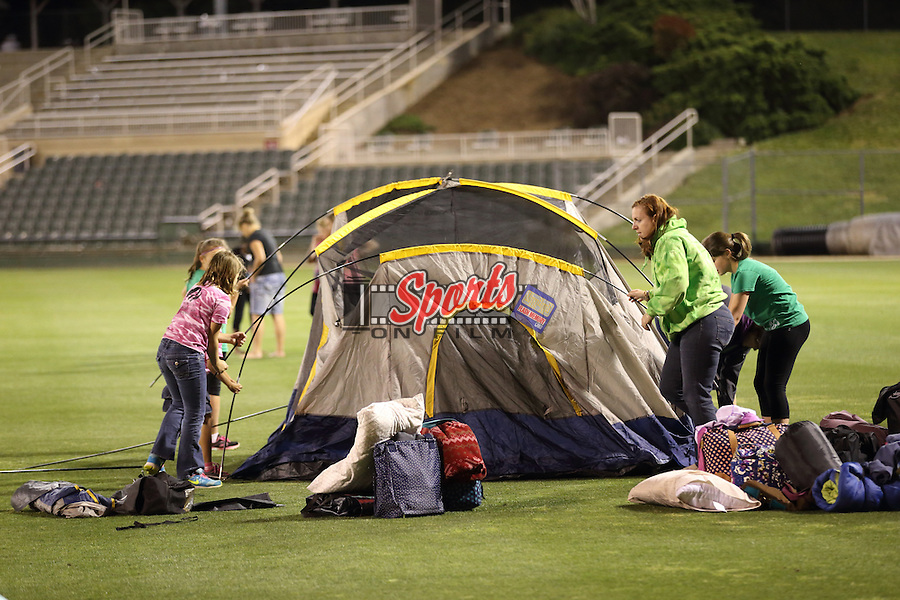 Approximately 150 members of the Girls Scouts set up their tents for an camp-out following the  game against the Delmarva Shorebirds at Kannapolis Intimidators Stadium on April 23, 2016 in Kannapolis, North Carolina.  (Brian Westerholt/Four Seam Images)