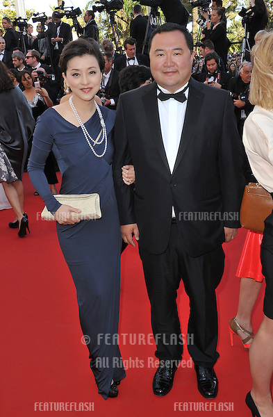 "Chinese media mogul Bruno Wu & actress wife Yang Lan at the gala premiere for ""Blood Ties"" at the 66th Festival de Cannes..May 20, 2013  Cannes, France.Picture: Paul Smith / Featureflash"