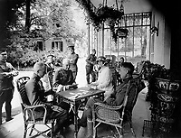 Wounded officers and Mrs. W.E.  Corey, wife of the American steel magnate, who has given her home to wounded American officers.  A game of bridge in progress on the veranda.  Chateau de Villegenis at Palaiseau, France.  September 18, 1918.  Sgt. R. Sullivan. (Army)<br /> NARA FILE #:  111-SC-23400<br /> WAR & CONFLICT BOOK #:  657