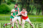 Bang Darragh O'Sullivan Dingle shoulders Kevin Gorman Kilcummin during their SFC relegation play off in Killorglin on Sunday