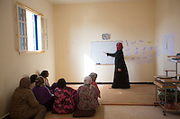 Morocco - Tidzi - Hafida El Hantati, 32, teaches Arabic to the ladies working at the Ajddigue cooperative.