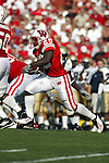 Madison, Wisconsin - 9/6/2003.  University of Wisconsin running back Anthony Davis (28) gains yardage during the University of Akron football game at Camp Randall. Davis rushed for 247 yards. Wisconsin beat Akron 48-31. (Photo by David Stluka).