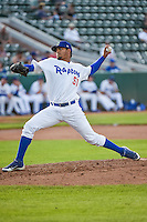 Roberth Fernandez (51) of the Ogden Raptors delivers a pitch to the plate against the Orem Owlz in Pioneer League action at Lindquist Field on June 18, 2015 in Ogden, Utah.  This was Opening Night play of the 2015 Pioneer League season. (Stephen Smith/Four Seam Images)
