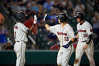 Rochester Red Wings Brian Schales (13) and Wynston Sawyer (16) high five Nick Gordon (1) after Schales hit a home run during an International League game against the Scranton/Wilkes-Barre RailRiders on June 24, 2019 at Frontier Field in Rochester, New York.  Rochester defeated Scranton 8-6.  (Mike Janes/Four Seam Images)