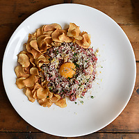 Melbourne, May 27, 2018 - A dish of steak tartare, Jerusalem artichoke chips, chestnut and rosemary at Gertrude Street Enoteca, Fitzroy, Australia. Photo Sydney Low